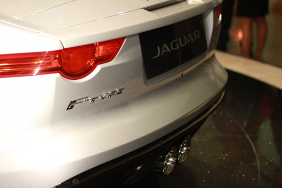 Rear of Model with 2014 Jaguar F-Type Convertible | Galpin Jaguar